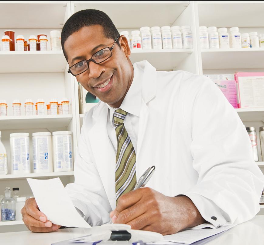 African american male pharmacist working in pharmacy
