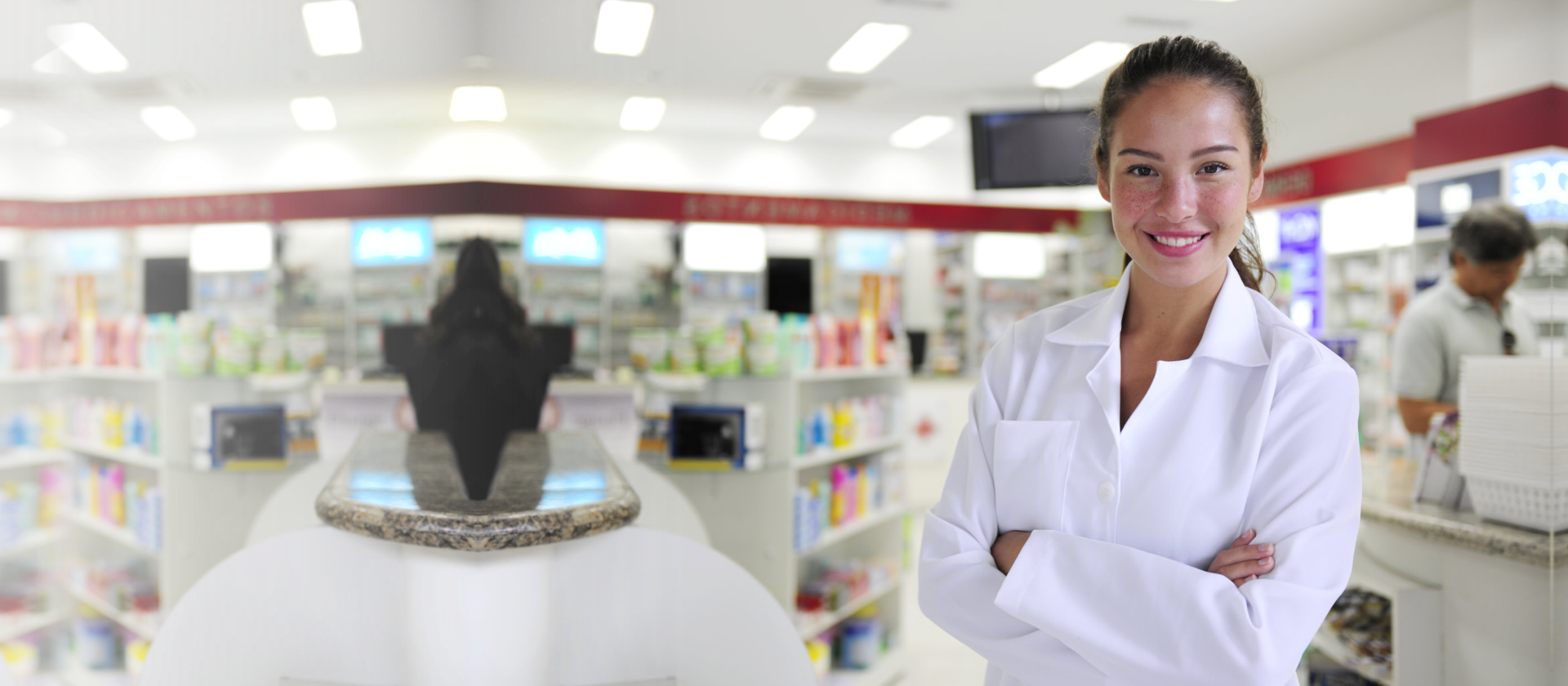 Portrait of a female pharmacist at pharmacy smiling