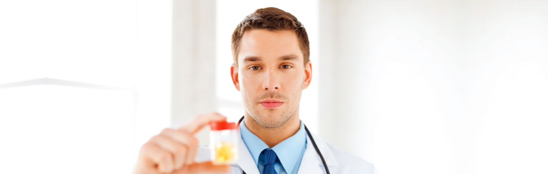 pharmacist showing a bottle of medicine